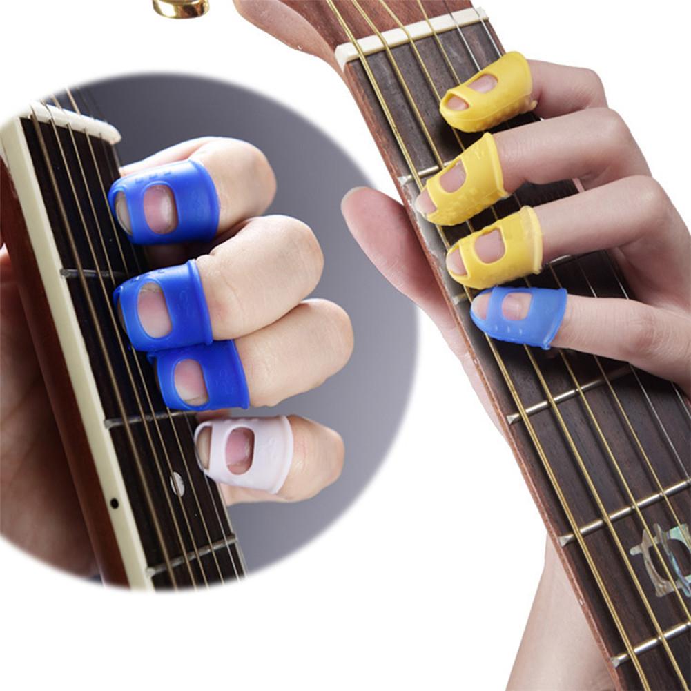 4 finger picks protector plectrum thumb fingertip cover for bass ukulele guitar 8438669386982 ebay. Black Bedroom Furniture Sets. Home Design Ideas