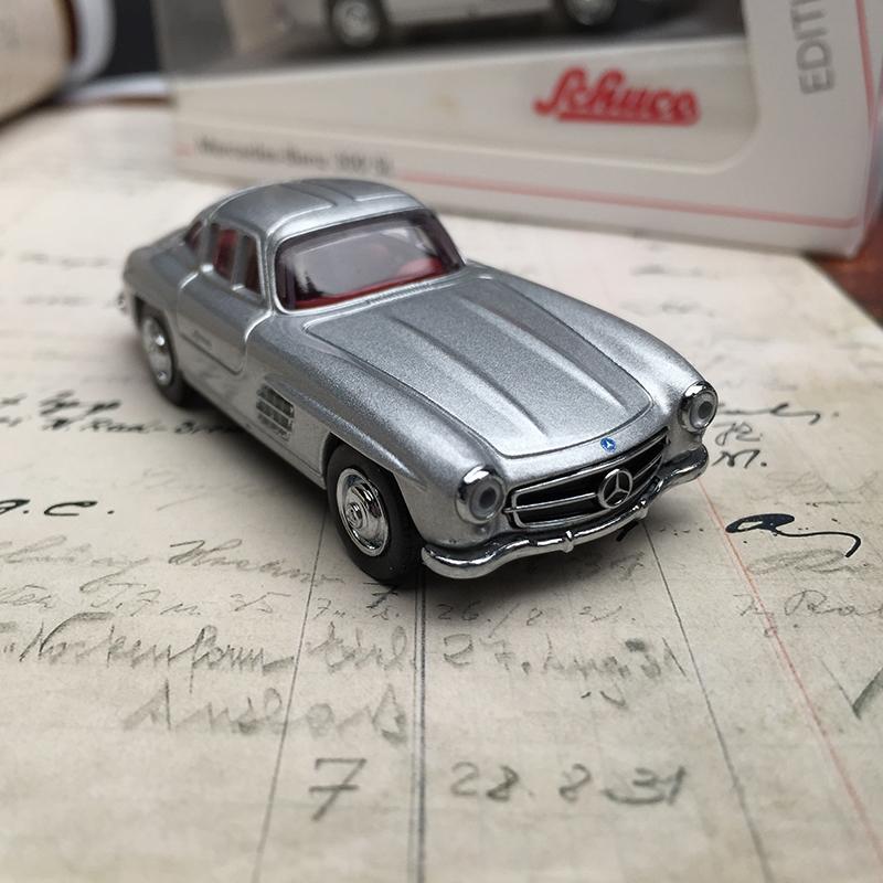 Schuco modelo 1:87 mercedes-benz 300 sl flügeltürer gris oscuro escudo esmaltes